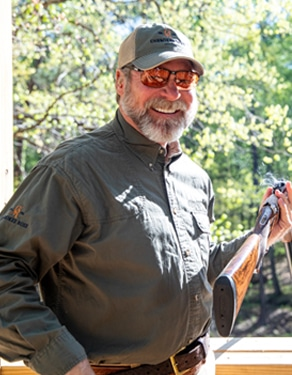Dave Owner Cherokee Rose Sporting Clays with empty shotgun